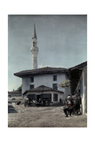 Villagers in Square are Reminded of Islamic Rule with Minaret in View Fotografiskt tryck av Wilhelm Tobien