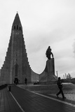 A Man Walks Out of Hallgrimskirkja Church Photographic Print by Jill Schneider