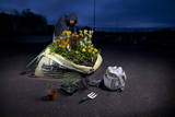 Guerrilla Gardener Planting a Flowerbed in a One Ton Sandbag at Night Photographic Print by Tom Gilks
