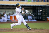 Jun 19, 2014, Boston Red Sox vs Oakland Athletics - Yoenis Cespedes Photographic Print by Jason O. Watson