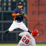 Apr 6, 2014, Los Angeles Angels of Anaheim vs Houston Astros - Jose Altuve, Raul Ibanez Photographic Print by Bob Levey