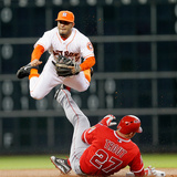Apr 5, 2014, Los Angeles Angels of Anaheim vs Houston Astros - Mike Trout, Jose Altuve Photographic Print by Bob Levey