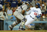Jun 18, 2014, Colorado Rockies vs Los Angeles Dodgers - Wilin Rosario, Yasiel Puig Photographic Print by Victor Decolongon