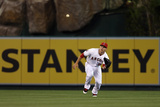 Mar 31, 2014, Seattle Mariners vs Los Angeles Angels of Anaheim - Mike Trout Photographic Print by Jeff Gross