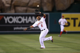 Aug 19, 2013, Cleveland Indians vs Los Angeles Angels of Anaheim - Erick Aybar Photographic Print by Jeff Gross