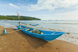 Outrigger Fishing Boat on West Beach of the Isthmus at This Major Beach Resort on the South Coast Photographic Print by Rob Francis