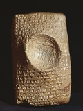 Babylonian Tablet with Cuneiform Inscription and Seal of the Hittite King Mursili II Photo