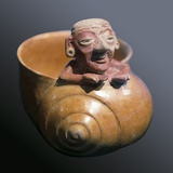 Snail Shaped Vessel with Figure of an Old Man Photo