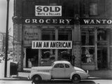 I Am an American Sign on a Store Front Photo