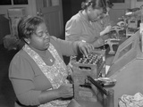 African American Women at the Melrose Park Buick Plant Reconditioning Used Spark Plugs Photo