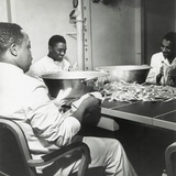 African American Steward Mates Dry Silverware in the Wardroom of the U.S.S. Ticonderoga Photo