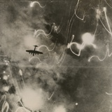 British Raf Bomber and Trails of Light from Incendiary Bombs Photo