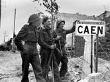 Canadian Soldiers at a Sign for the Port City of Caen Photo
