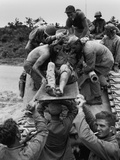 Wounded Marine Is Removed from a Tank That Carried Him from the Front Lines on Okinawa Photo
