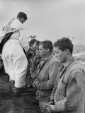 U.S. Marines and a Chaplain Celebrate Catholic Communion During the Battle of Iwo Jima Photo