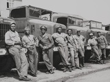 African American Officers and Mechanics Standing in Front of Army Trucks Photo