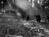 U.S. Soldiers Advance in the Cover of a Tank on Bougainville Photo