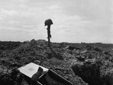 Helmet and Rifle Monument to a Dead U.S. Soldier on a Shell-Blasted Beach of France Photo