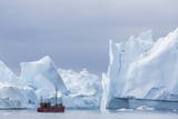 A Commercial Iceberg Tour Amongst Huge Icebergs Calved from the Ilulissat Glacier Photographic Print by  Michael