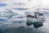 A Commercial Iceberg Tour Amongst Huge Icebergs Calved from the Ilulissat Glacier Impressão fotográfica por  Michael