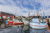 Commercial Fishing and Whaling Boats Line the Busy Inner Harbor in the Town of Ilulissat Photographic Print by  Michael