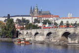 View over the River Vltava with Excursion Boat to Charles Bridge and the Castle District Photographic Print by  Markus