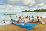 Outrigger Fishing Boat and People Pulling Net in by Hand to Shore Near Batu Karas Photographic Print by  Rob
