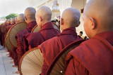 Line of Novice Monks Waiting for Donated Gifts Photographic Print by  Lynn