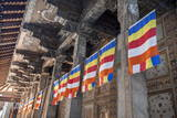 Colourful Buddhist Flags Adorning Columns Photographic Print by  Charlie