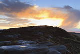Person on Rocks of Stanage Edge with Winter Sunrise Photographic Print by  Eleanor