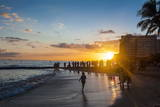 Sunset over the High Rise Buildings on Waikiki Beach Photographic Print by  Michael