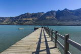 Wooden Pier in the Turquoise Water of Lake Wakatipu Photographic Print by  Michael