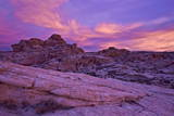 Vibrant Orange Clouds over Red and White Sandstone at Sunset Photographic Print by  James