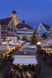 Christmas Fair in the Market Place with Stiftskirche Church Photographic Print by  Markus