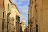 View Down a Narrow Street with Golden Stone Photographic Print by  Eleanor