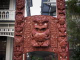 Carved Gateway Marking Entrance to Te Herenga Waka Marae Photographic Print by Nick Servian