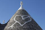 Heart Painted on Roof of Traditional Trullo in Alberobello Photographic Print by  Martin