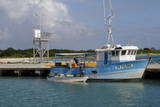 Fishing Boat in Harbour in Barbuda Photographic Print by  Robert