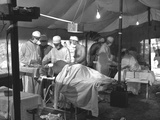 U.S. Navy Doctors and Corpsmen Operate on Two Wounded Marines on Cape Gloucester Photo