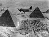American Air Transport Command Plane Flies over the Pyramids of Egypt Photo