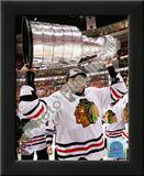 Dustin Byfuglien with the 2009-10 Stanley Cup Art