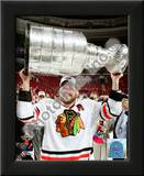 Patrick Sharp with the 2009-10 Stanley Cup Posters