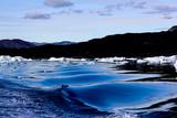 Iceberg and Waves in Greenland Photographic Print by Françoise Gaujour