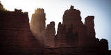 Sun Rises from Behind the Fisher Towers - Moab, Utah Photographic Print by Dan Holz