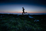 A Young Woman on a Sunset Run Along a Wild Stretch of the California Coastline Photographic Print by Steven Gnam