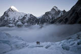 Climbers Navigate the Khumbu Icefall with Pumori and Lingtrin in the Background in Nepal Photographic Print by Kent Harvey