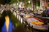 Boats in the Canal Near the Zuiderkerk Church in Amsterdam, Netherlands Photographic Print by Carlo Acenas