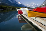 Glacier, Montana: Colorful Canoes Line the Dock at Many Glacier Lodge on Swiftcurrent Lake Photographic Print by Brad Beck