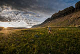 A Woman Trail Running in Glacier National Park, Montana Photographic Print by Steven Gnam