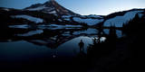 A Silhouette of a Person at Dusk at Camp Lake with South Sister Reflected, Oregon Cascades Photographic Print by Bennett Barthelemy